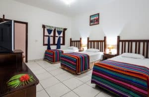 One of the triple bed hotel rooms in Roatan Splash Inn Hotel