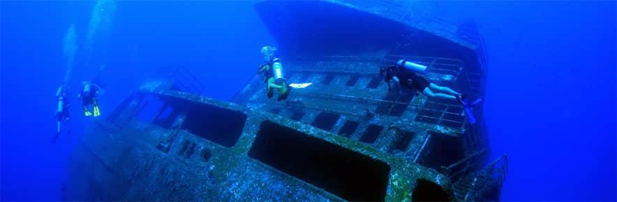 The odyssey shipwreck roatan diving sites splash inn - Roatan dive sites ...